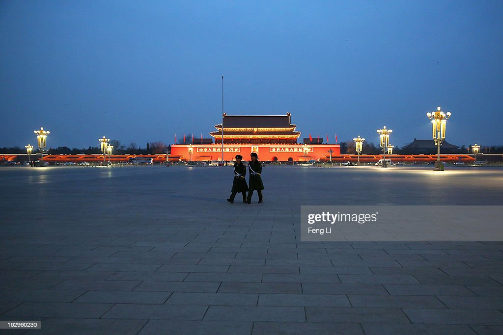 Two paramilitary police officers patrol at Beijing's Tiananmen Square on March 2, 2013 in Beijing, China. The reshuffle will be completed at the first annual session of the 12th National People's Congress (NPC), which is scheduled to begin on March 5, and the first annual session of the 12th National Committee of the Chinese People's Political Consultative Conference (CPPCC), which will commence on March 3.