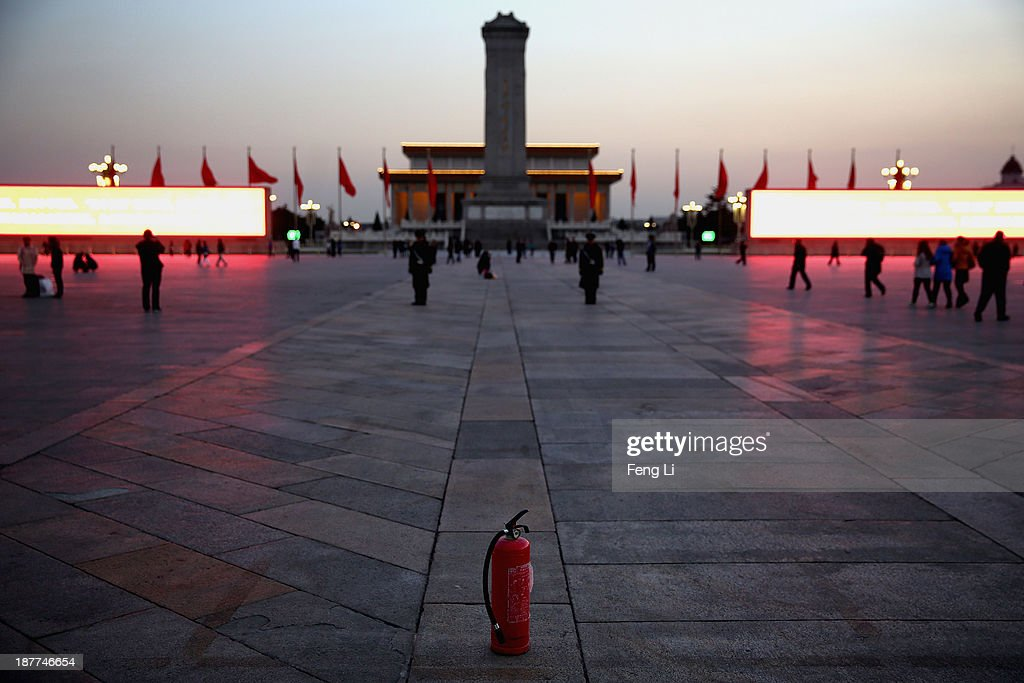 Two paramilitary policemen guard behind a fire extinguisher at the Tiananmen Square outside the Great Hall of the People where the Communist Party's 205-member Central Committee gathered for its third annual plenum on November 12, 2013 in Beijing, China. The 18th Central Committee of the Communist Party of China (CPC) approved a decision on 'major issues concerning comprehensively deepening reforms' at the close of the Third Plenary Session of the 18th CPC Central Committee on Tuesday.
