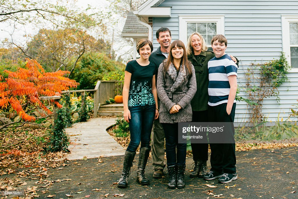 Two Parent Family with three teenage children at home : Stock Photo