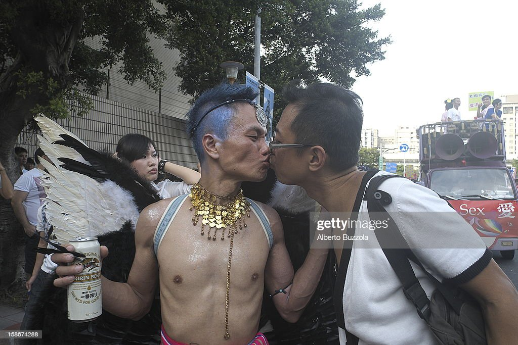 Two participants at the annual Gay and Lesbian Pride Parade kissing each other during the parade..