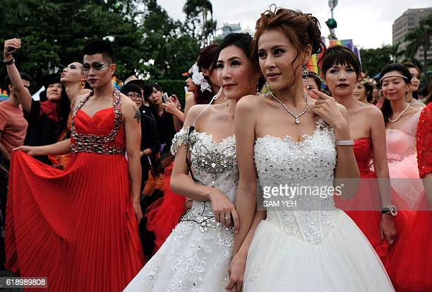 Two participants pose during the annual Taiwan lesbian gay bisexual and transgender pride parade in Taipei on October 29 2016 Thousands of the...