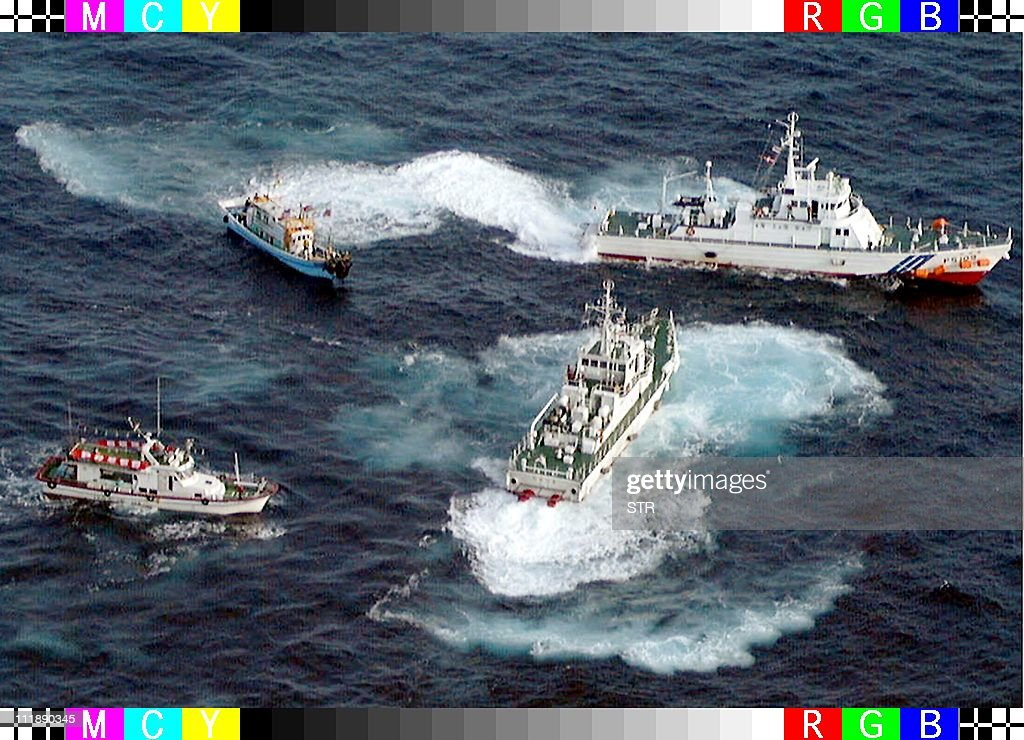 Two patrol ships of the Japanese coastal guards attempt to stop Taiwanese fishing boats heading to the disputed DiaoyuSenkaku island in the East...