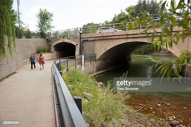 Two pedestrians who did not give their names walk by the Animas River on August 11 2015 in Durango Colorado The Environmental Protection Agency...