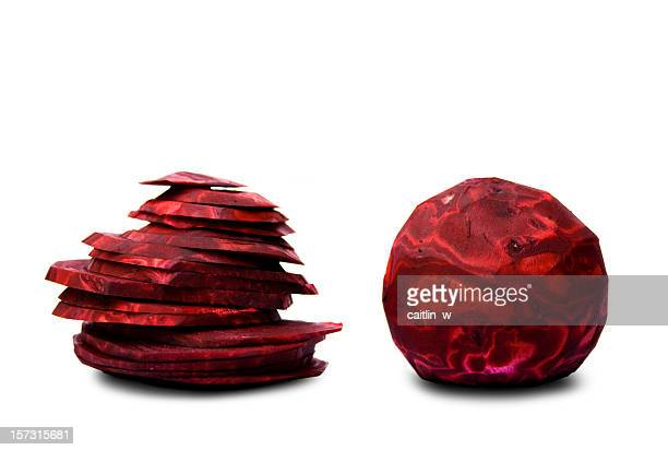 Two peeled and sliced red beets