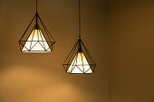 Two pendant lamps hanging on ceiling. Contemporary Design.