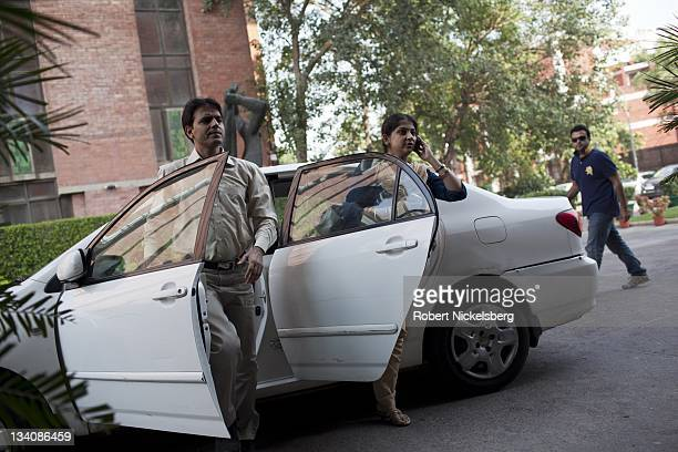 Two people arrive by car and driver at a hotel October 23 2011 in New Delhi India The Indian middle class estimated to be 50 million people has seen...