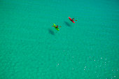 Two people canoeing in Gulf of Mexico, Destin, Florida, USA