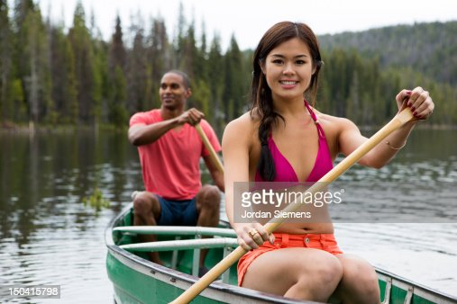 Two people canoeing on a lake. : Stock Photo