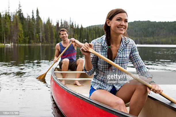 Two people canoeing on a lake.