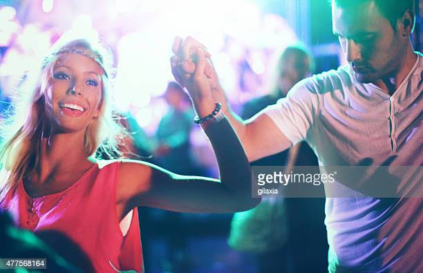 Two people dancing at concert.
