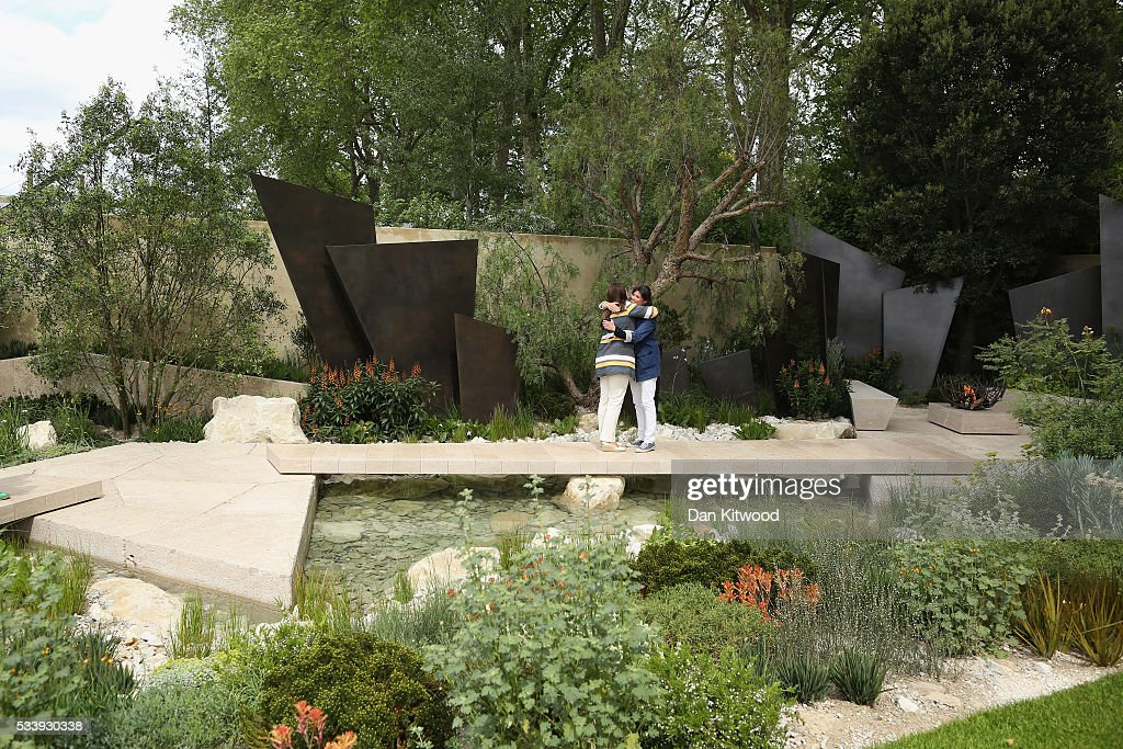 Two people embrace at the Telegraph Garden which has won 'Best Show Garden' at the 2016 Chelsea Flower Show at Royal Hospital Chelsea on May 24, 2016 in London, England. The show, which has run annually since 1913 in the grounds of the Royal Hospital Chelsea, is open to the public from 24-28 May.