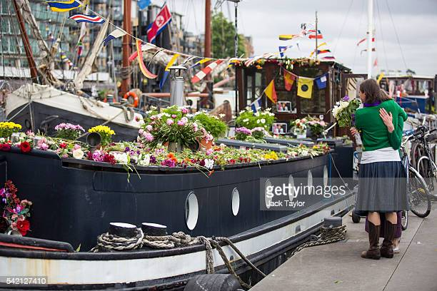 Two people embrace beside the houseboat of the late Jo Cox at Hermitage Moorings on the River Thames June 22 2016 in London United Kingdom A floating...
