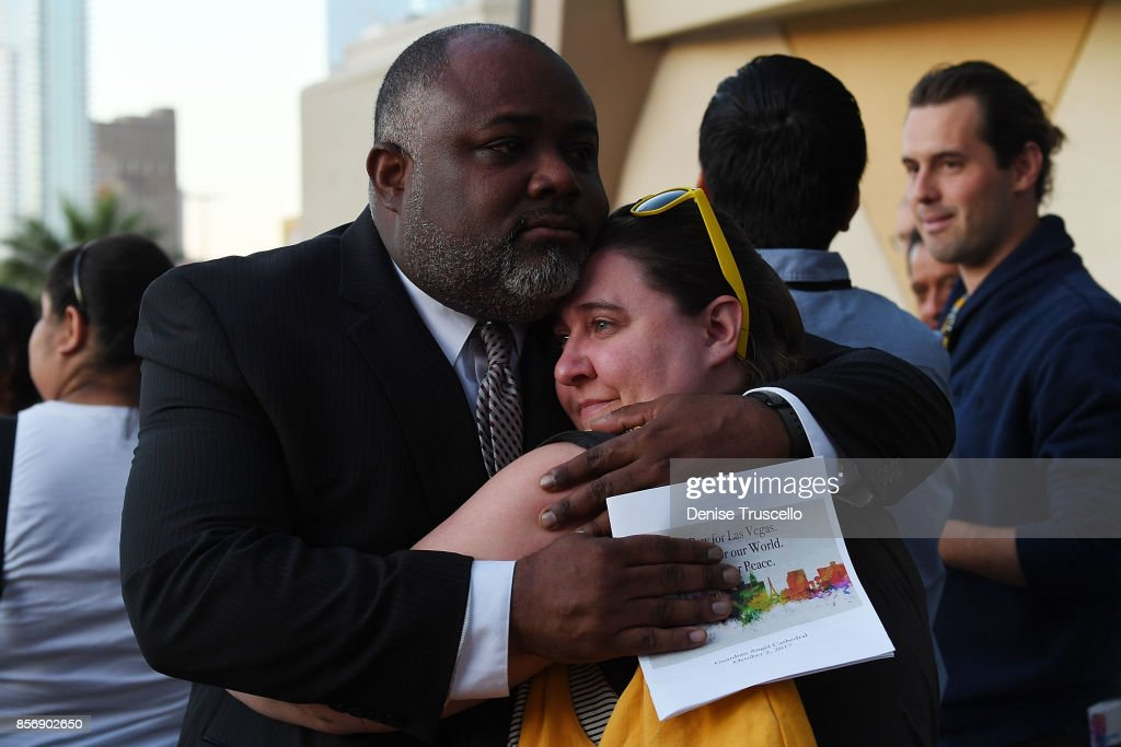 Two people embrace during a vigil at Guardian Angel Cathedral for the victims of the Route 91 Harvest country music festival shootings on October 2, 2017 in Las Vegas, Nevada. Lone gunman Stephan Paddock, 64, of Mesquite, Nevada opened fire on festival attendees leaving at least 59 dead and over 500 injured before killing himself. The investigation is ongoing.