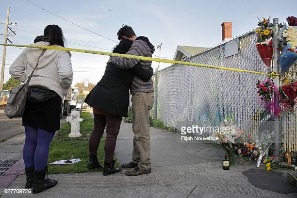 Two people embrace following a small ceremony involving sage near the site of a warehouse fire that has claimed the lives of at least thirtythree...