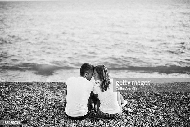 Two people embracing on the background of sea coast