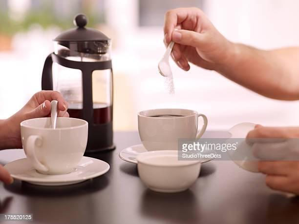 two people  enjoying a coffee