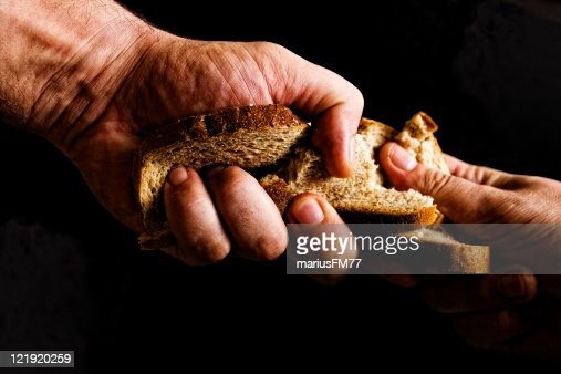 Two people fighting over piece of bread