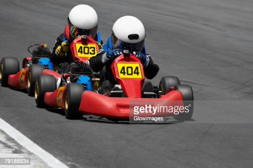 Two people go-carting on a motor racing track : Stock Photo