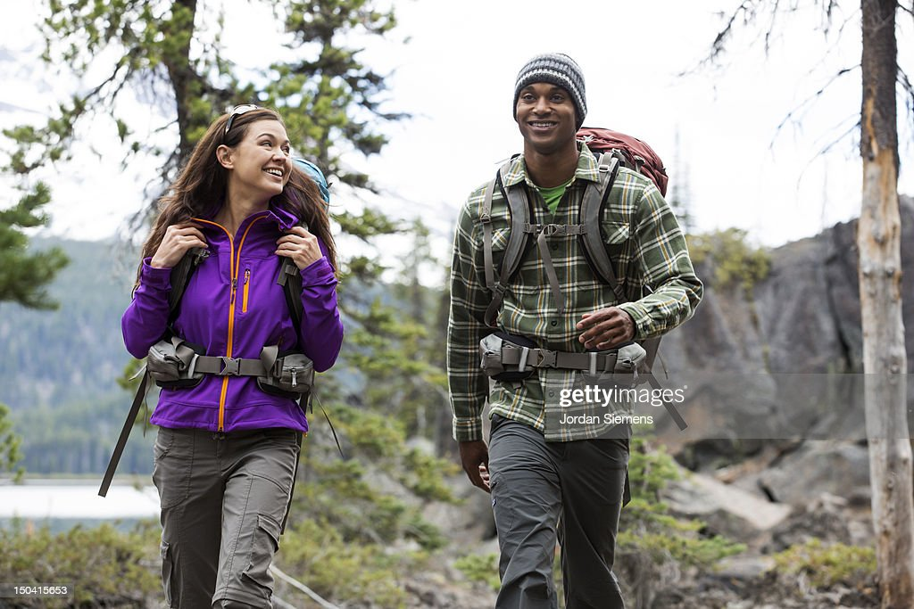 Two people hiking with backpacks. : Stock Photo