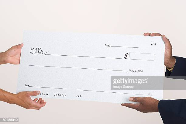 Two people holding a cheque