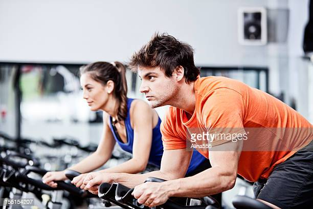 Two people in a cycling class