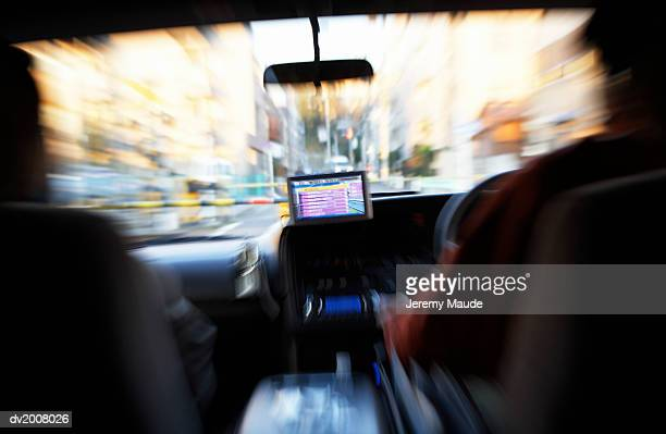 Two People in a Taxi With GPS, Shibuya, Tokyo, Japan