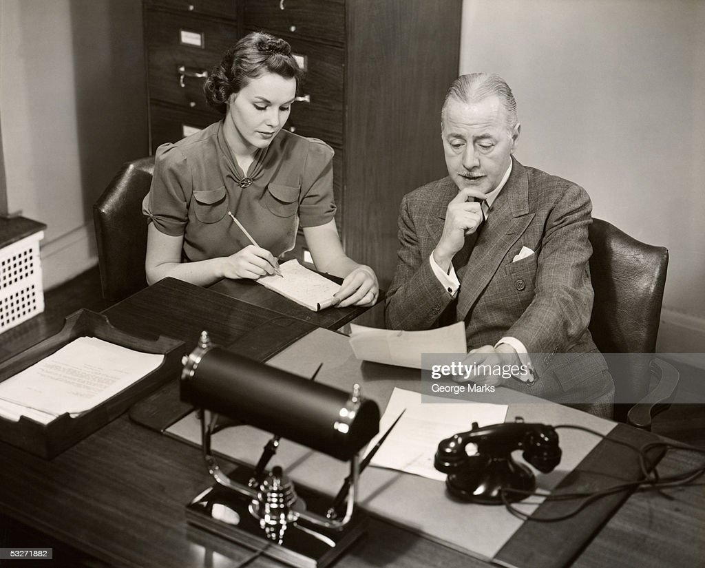 Two people inside office at meeting : Stock Photo