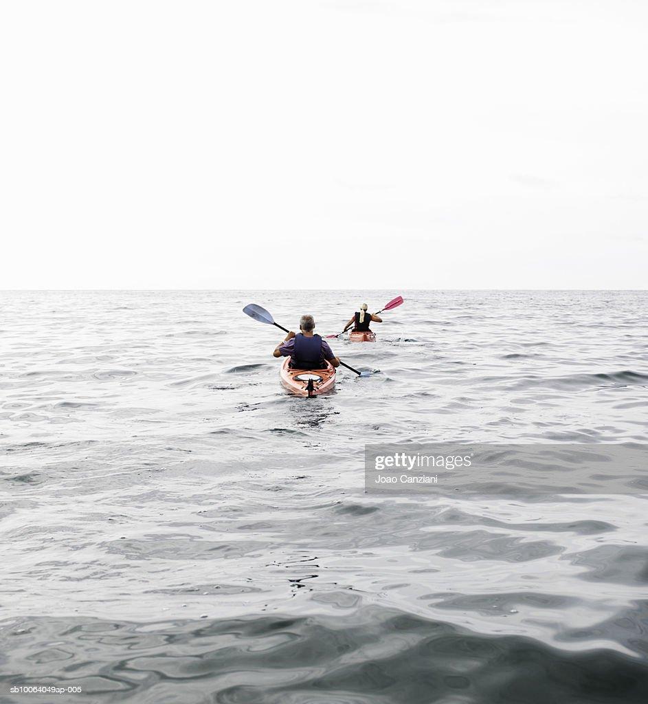 Two people kayaking in sea : Stock Photo