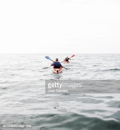 Two people kayaking in sea : Stock Photo