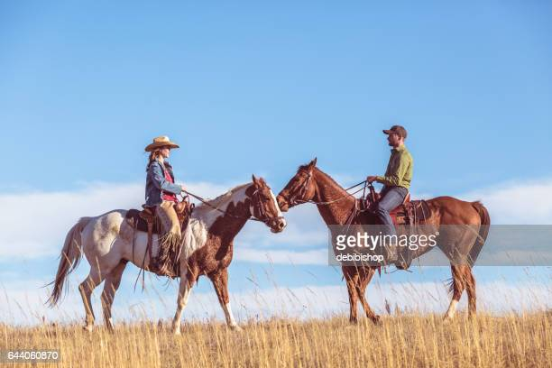 Two People On Horseback Riding Toward Each Other