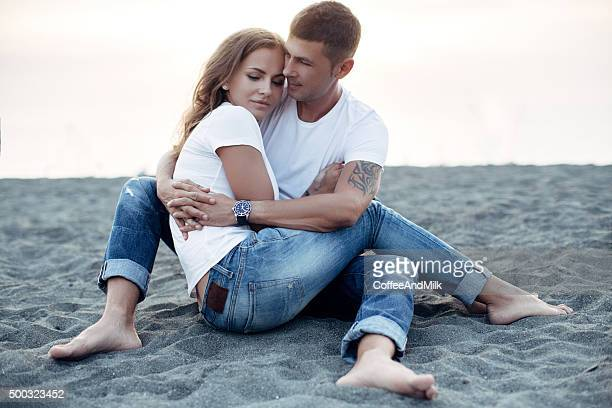 Two people on the background of sea coast
