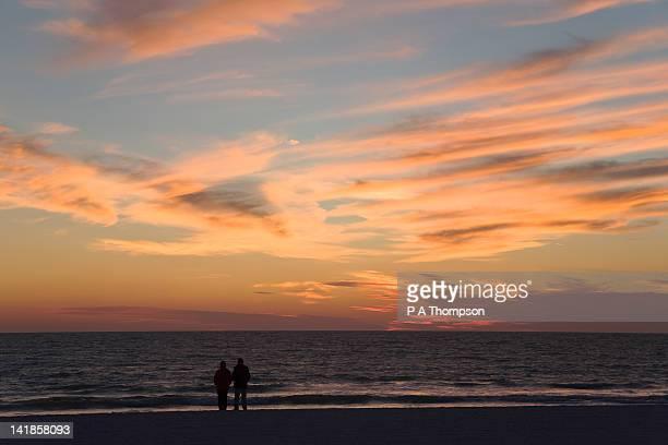 Two people on the beach at sunset, Sarasota, Florida, USA