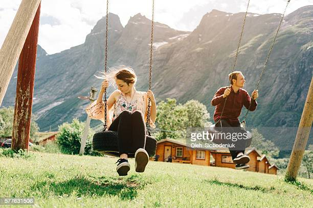 Two people  on the swing