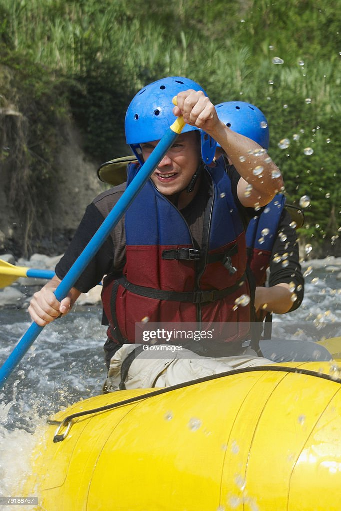 Two people rafting in a river : Foto de stock