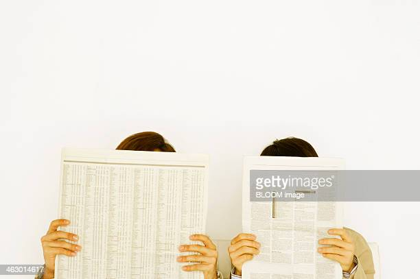 Two People Reading Newspaper
