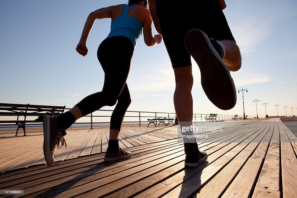 Two people running on promenade : Stock Photo