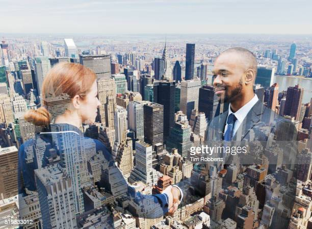 Two people shaking hands with New York buildings.