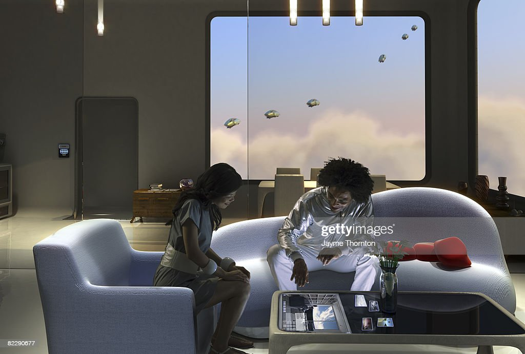 Two people sharing pictures on touch screen table : Stock Photo