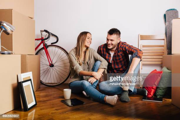 Two people sitting at floor