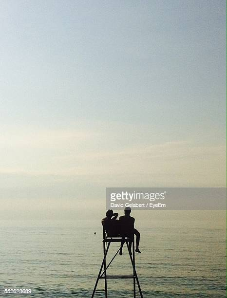 Two People Sitting On Lifeguard Chair
