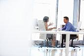 Two people talking in an office
