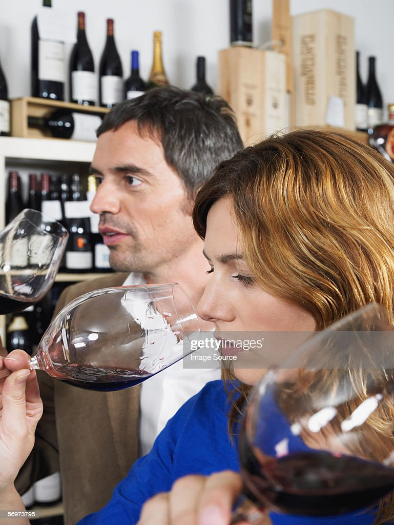 Two people tasting wine : Stock Photo