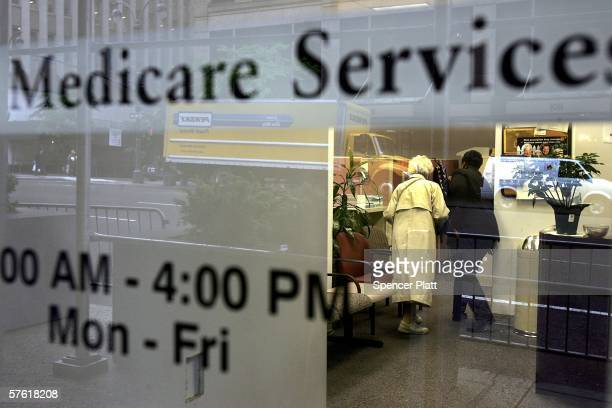 Two people walk inside a Medicare Services office on the last day for enrollment in the Medicare Part D program May 15 2006 in New York City...