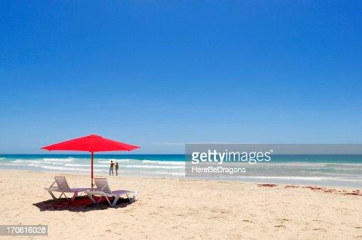 Two People Walking On Desolate Caribbean Beach Stock Photo ...