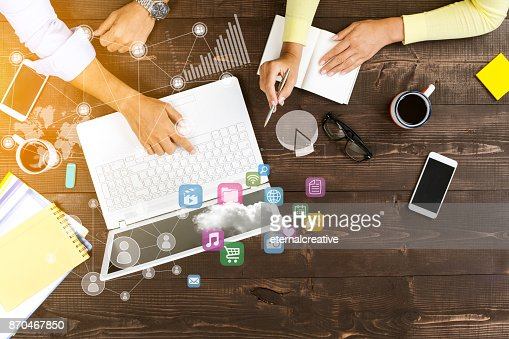 Two people working on computer : Stock Photo