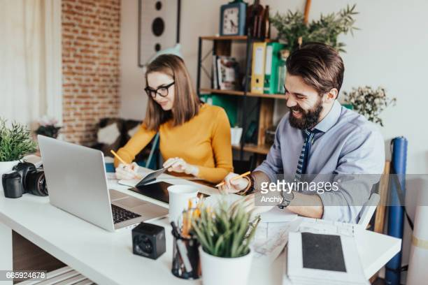 Two people working together in a home office