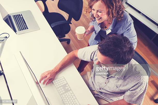 Two people working together with computer.