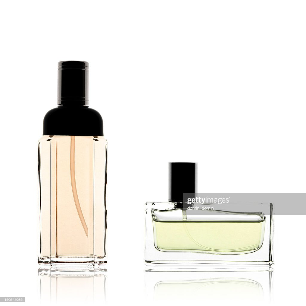 Two perfume bottles vertical and horizontal, isolated on white
