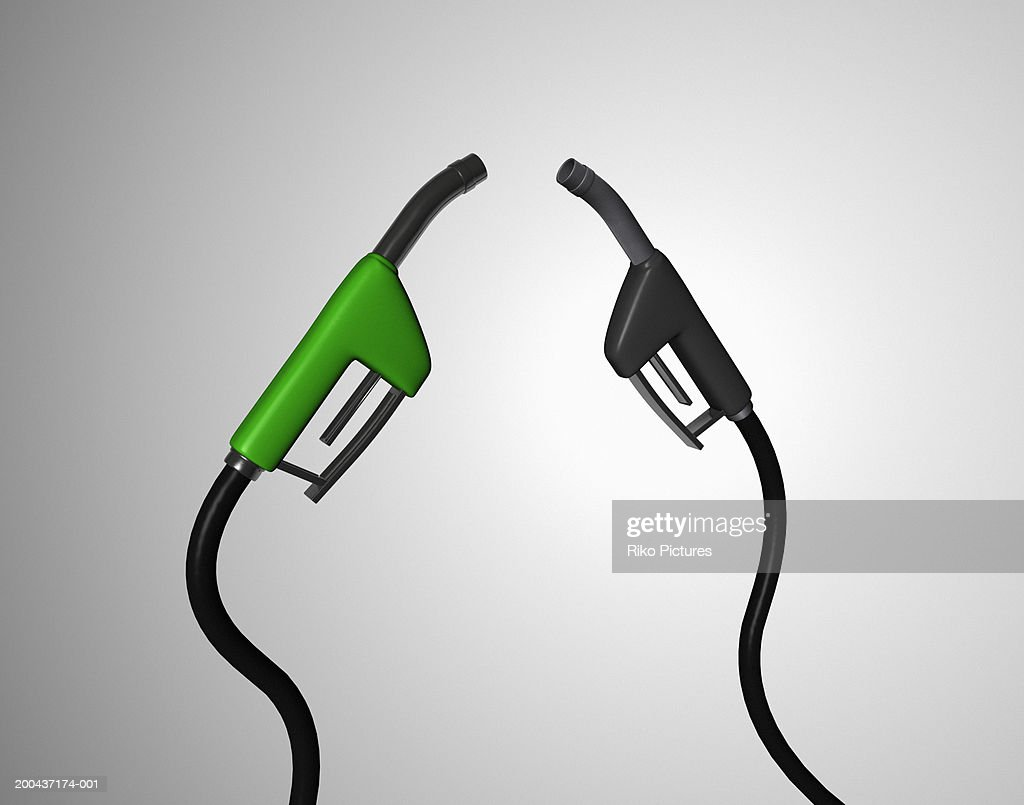 Two petrol pumps for unleaded and diesel fuel (Digital Composite)