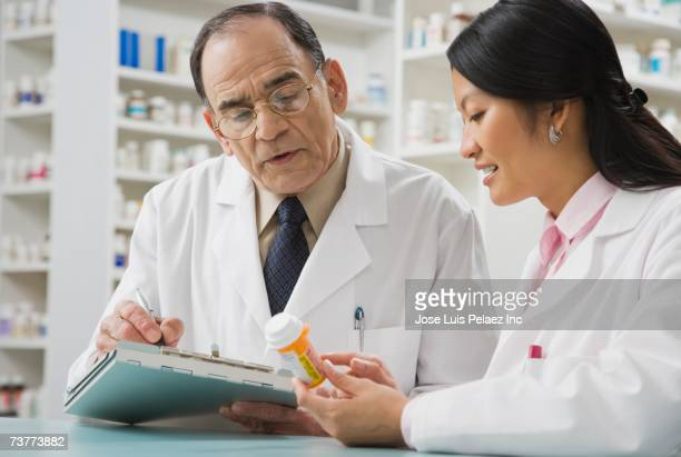 Two pharmacists discussing medication